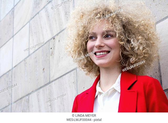 Portrait of laughing blond woman with ringlets