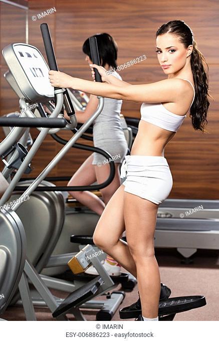 Women doing exercise in gym center