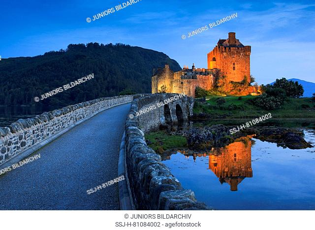 Eilean Donan Castle in the evening. The castle is built in a small island where three lochs converge - Loch Alsh, Loch Long, and Loch Duich
