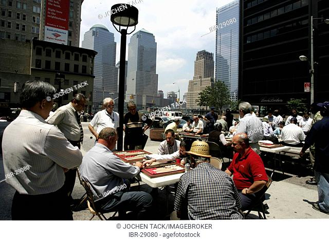 USA, United States of America, New York City: Downtown, Financial District. Lunch break, Liberty Street, Backgammon games