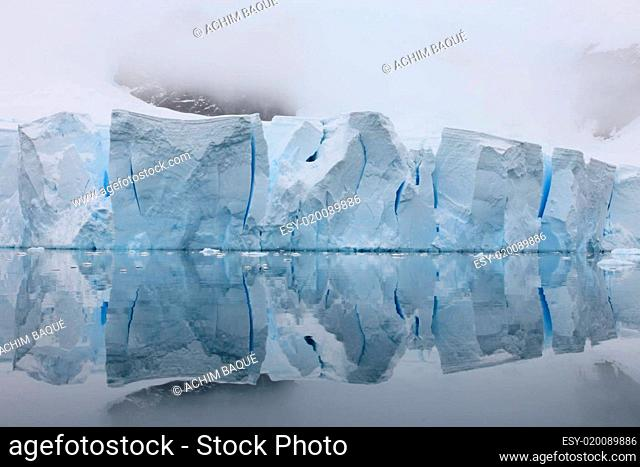 Glacier with reflections on water