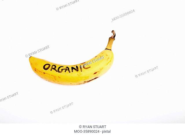 Organic banana against white background