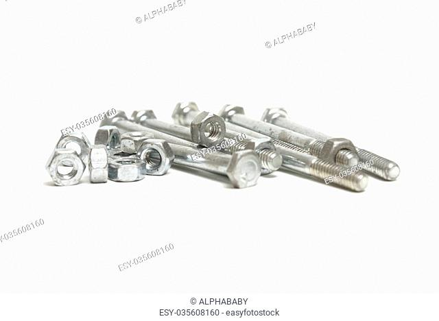 A pile of nuts and a bolts isolated on white