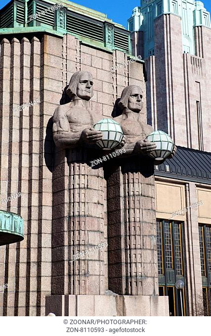 HELSINKI, FINLAND - MARCH 17, 2013: Statues holding the spherical lamps at the Helsinki Central railway station on march 17, 2013 in Helsinki, Finland