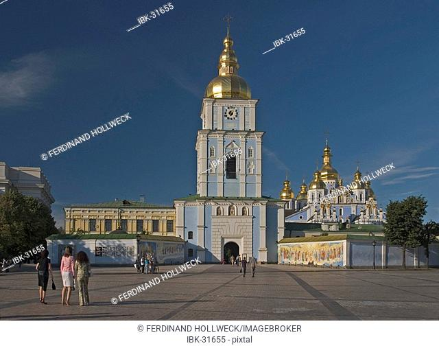 Ukraine Kiev Michael place with belltower 1720 Michael monastery with golden domes and crosses 1113 monastery wall with paintings Fresken 1775 tourists blue sky...