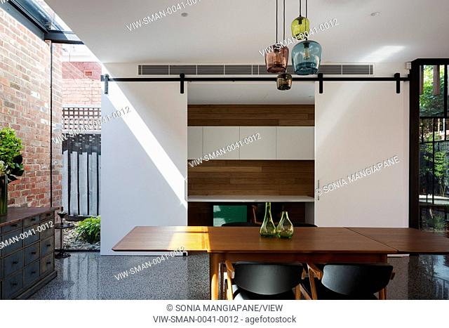 View of dining area looking through to study/office area which can be sectioned off. Vail Street House, Melbourne, Australia