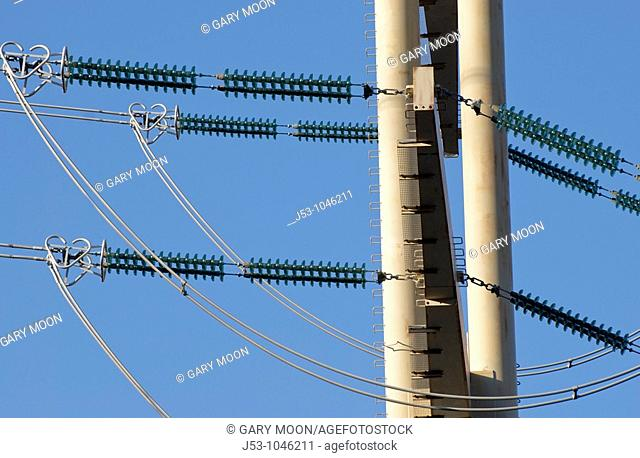 Detail of electrical powerline and insulators on high voltage tower