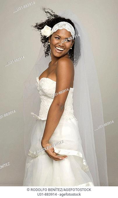Black Latin Bride in her 20s smiles happily