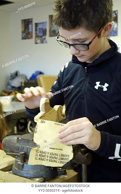 8th Grade Boy Sanding in Technology Class, Wellsville, New York, USA