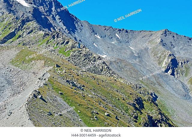 The wild setting of the modern Velan Mountain Hut in the southern swiss alps near the italian border