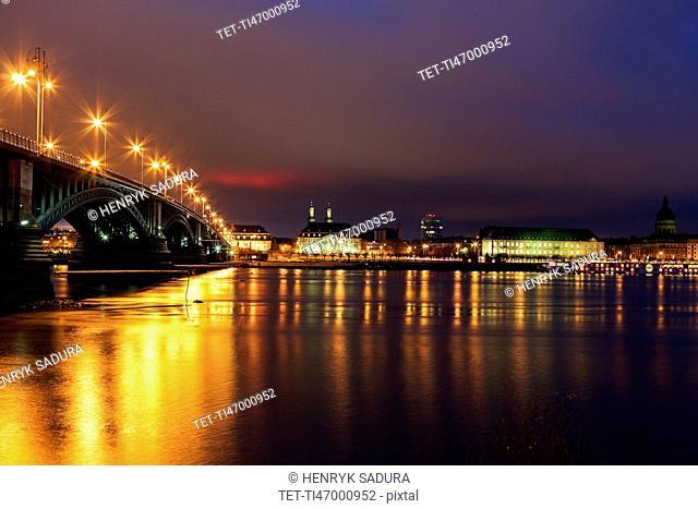 Illuminated Theodor Heuss Bridge and waterfront skyline