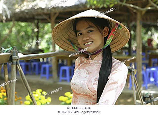 A Vietnamese woman in national costume, Cu Lao Thai Son Island, Vietnam