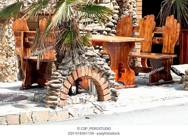 Outdoor Wooden Bench And Table In Restaurant