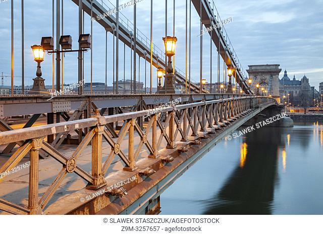 Dawn at Chain Bridge across Danube river in Budapest, Hungary