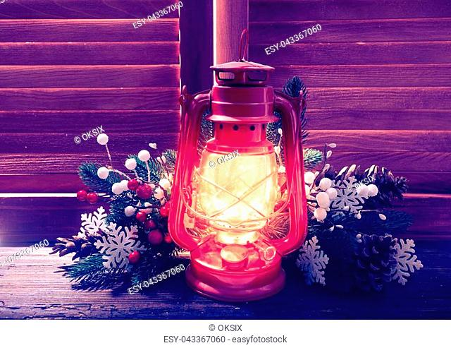 Kerosene lamp in the night on the window outdoor, Christmas decorations