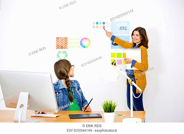 Women working at desk In a creative office, team work
