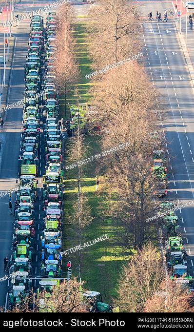 17 January 2020, Lower Saxony, Hanover: Tractors park on the Friedrichswall in front of the New Town Hall. With rallies in various places