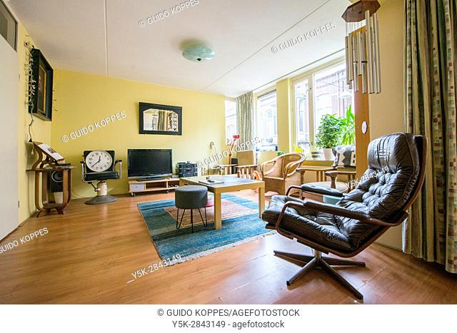 Tilburg, Netherlands. Interior shot of an apartment living room with saloon chairs and furniture