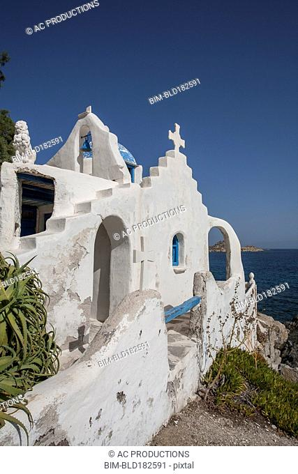 Traditional church on rocky oceanfront