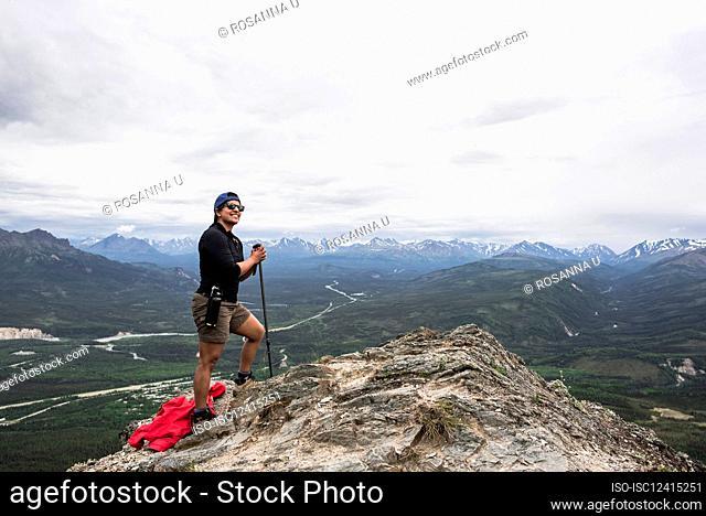 USA, Alaska, Female hiker on mountain top in Denali National Park