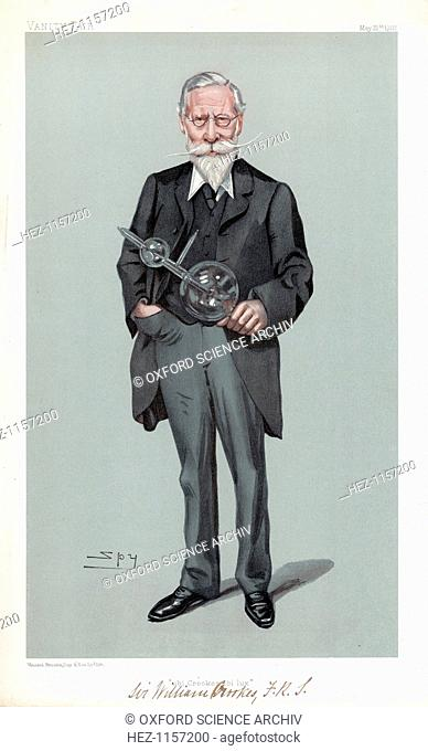 William Crookes, British physicist and chemist, 1903. Crookes (1832-1919) holding the discharge tube which carries his name
