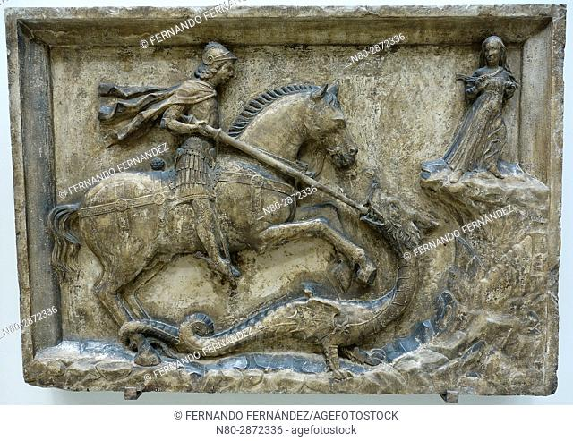 St George and the Dragon Flanked by the Dandolo Arms. Italy. Venice. Istrian stone. About 1500. The Victoria and Albert Museum. London. England