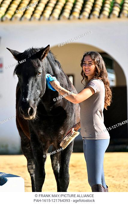 Exclusive: The equestrienne and horse coach Kenzie Dysil with her horse James, Spain, city of Villamartín, 05. December 2018