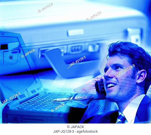 Briefcase, laptop and man on phone