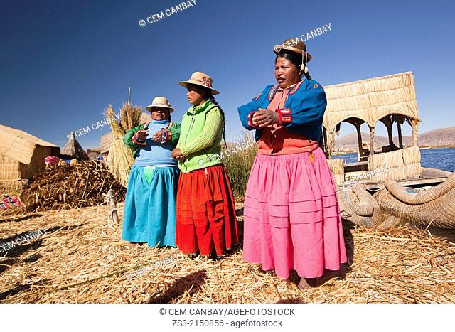 Aymara women singing songs for welcoming tourists, Uros Islands, Lake Titicaca, Puno Region, Peru, South America