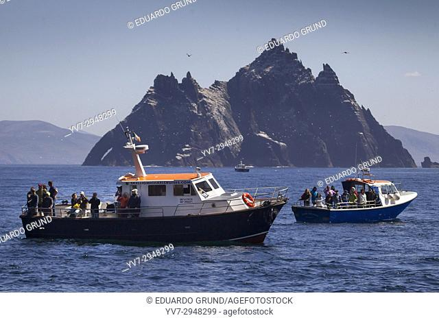 Excursion boats arriving at Great Skellig or also called Skellig Michael. Skellig Islands, County Kerry, Ireland, Europe
