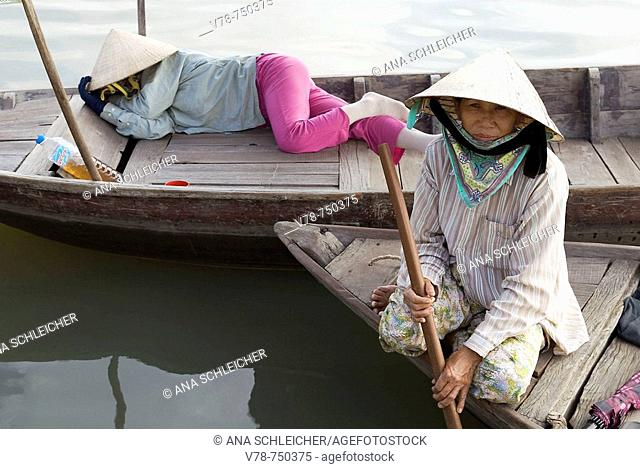 Boatwomen waiting for tourists. Hoi An. Central Vietnam