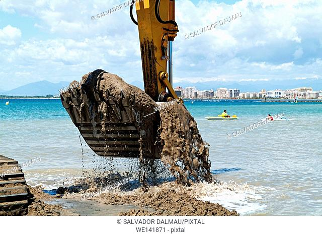 Collect sea sand to put on the beach, Location of roses, Girona, Catalonia, Spain, Europe