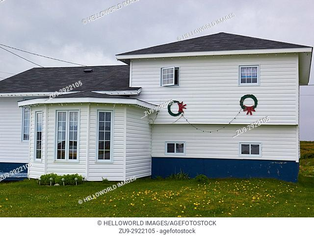 Christmas decorations on a painted wooden house, Newfoundland, Canada