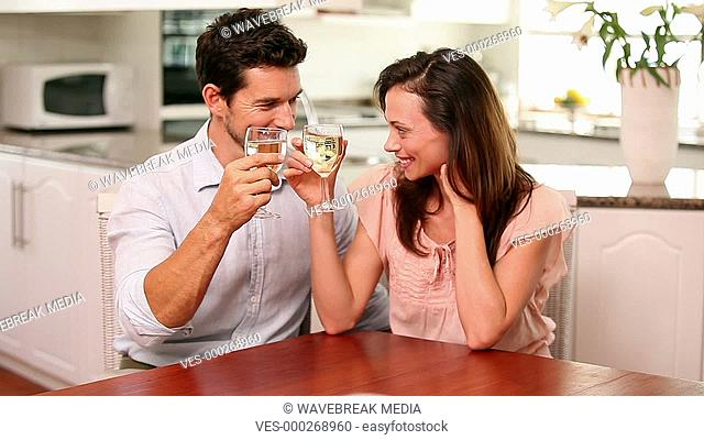 Happy couple drinking white wine together
