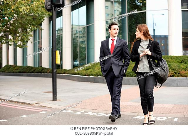 Business people walking in city talking