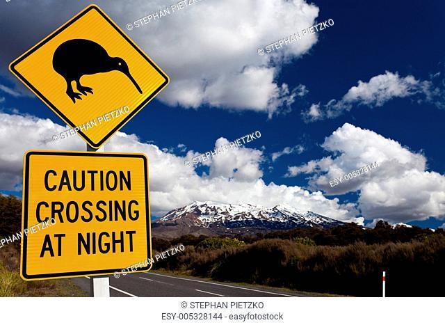 Kiwi Crossing road sign and volcano Ruapehu, NZ