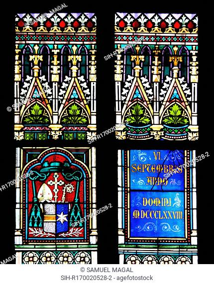Part of a Stained Glass Window depicting a Coat of Arms symbol, an inscription mentioning the year 1878 in Roman letters and decorative motifs below and above