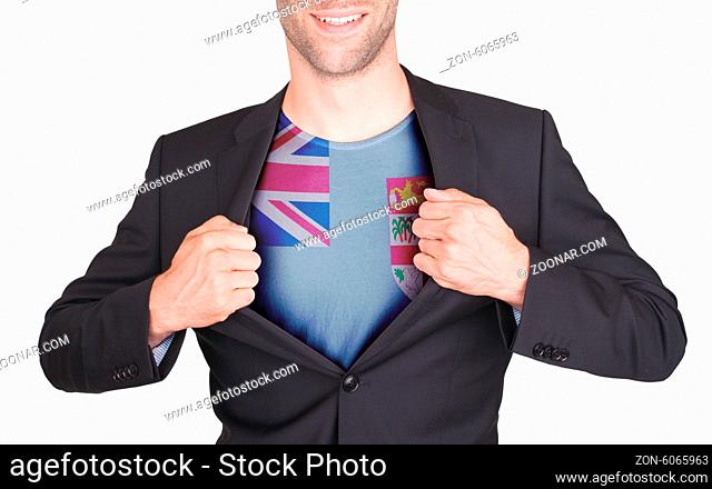 Businessman opening suit to reveal shirt with flag, Fiji