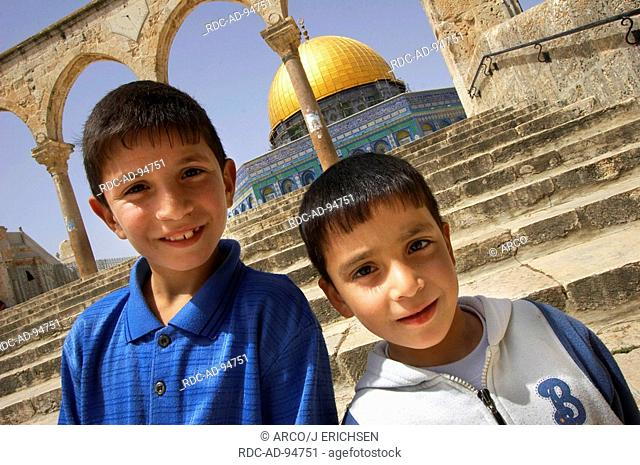 Palestine boys in front of the Dome of the Rock Temple Mount old part of Jerusalem Israel