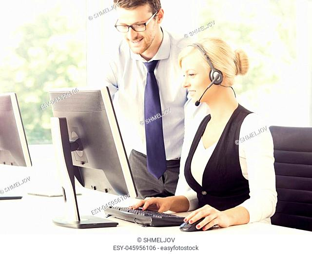 People working in a call center office. Man and woman at work. Business support concept