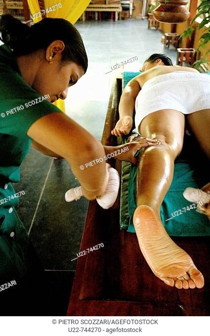 Saligao Goa, India, a woman receiving an ayurvedic massage with oil at the Ayurvedic Natural Health Centre