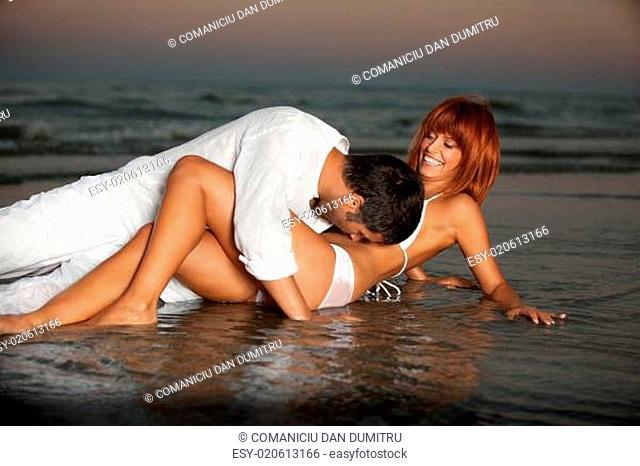 happy, romantic couple, by the sea shore