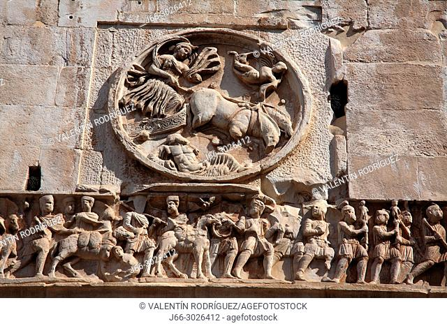 Detail of engraving on the Arch of Constantine and Colosseum. Rome. Italy