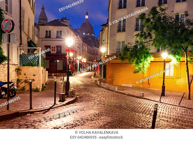 Empty street and the Sacre-Coeur in the morning, quarter Montmartre in Paris, France