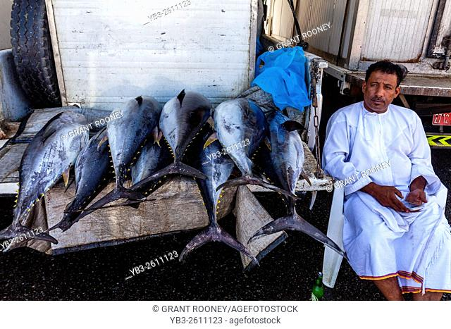 An Omani Man Sells Fish At The Fish Market, Muttrah, Muscat, Sultanate Of Oman