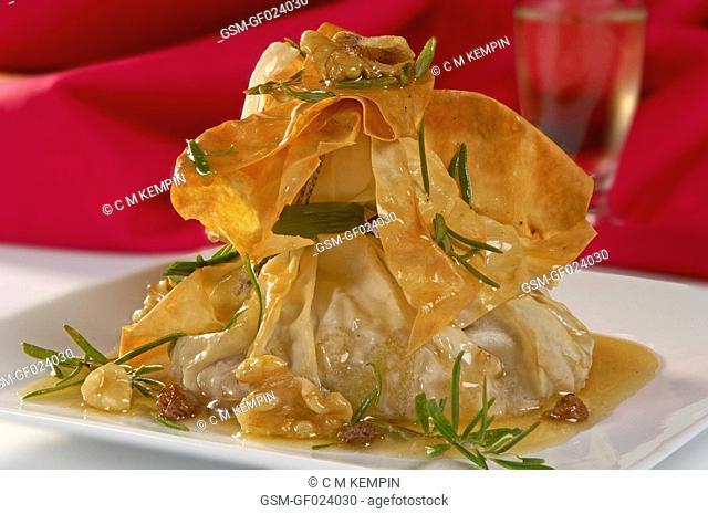 Apple, walnut, and rosemary pastry purses