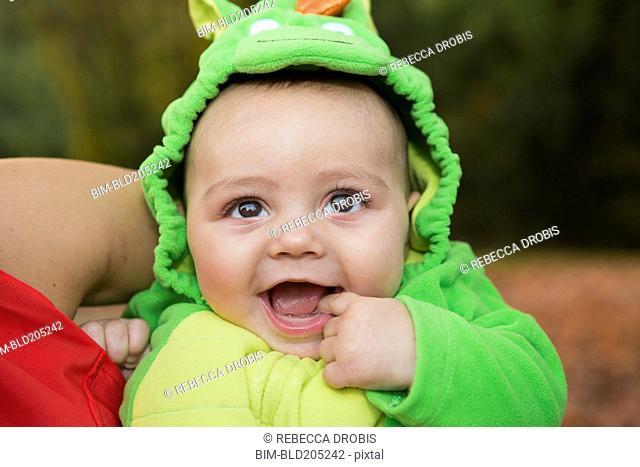 Smiling baby wearing costume