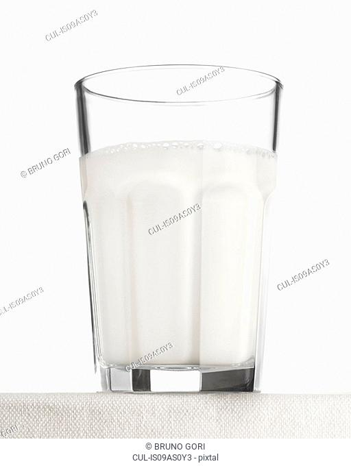 Close up of drinking glass of frothy effervescent water