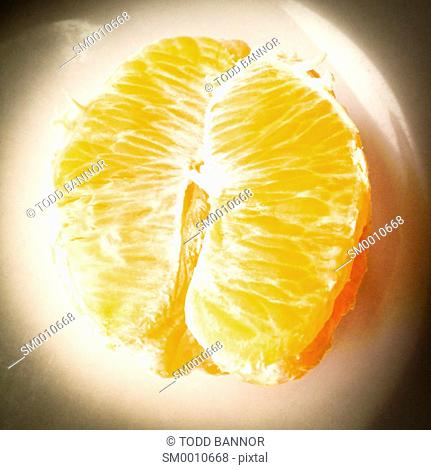 Sections of an orange on a plate