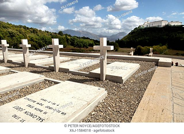 Gravestones in the Polish Cemetery standing proud towards the Abbey at Monte Cassino